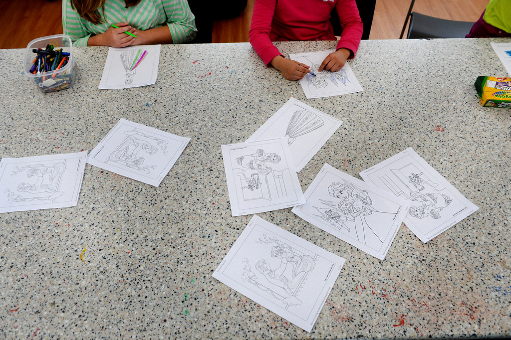 . Children take time after school to do calming activities such as coloring in their residential cottages on campus at  Mount Saint Vincent Home in in Denver,  Co on March 19, 2014. (Photo By Helen H. Richardson/ The Denver Post)