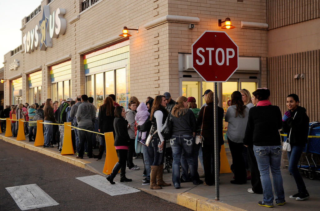 . Hundreds of shoppers line up to get into the the Toys R Us store on County Line Road in Arapahoe County Thursday night, November 28, 2013. Many metro area stores got a jump on Black Friday by opening Thanksgiving night. Photo By Karl Gehring/The Denver Post