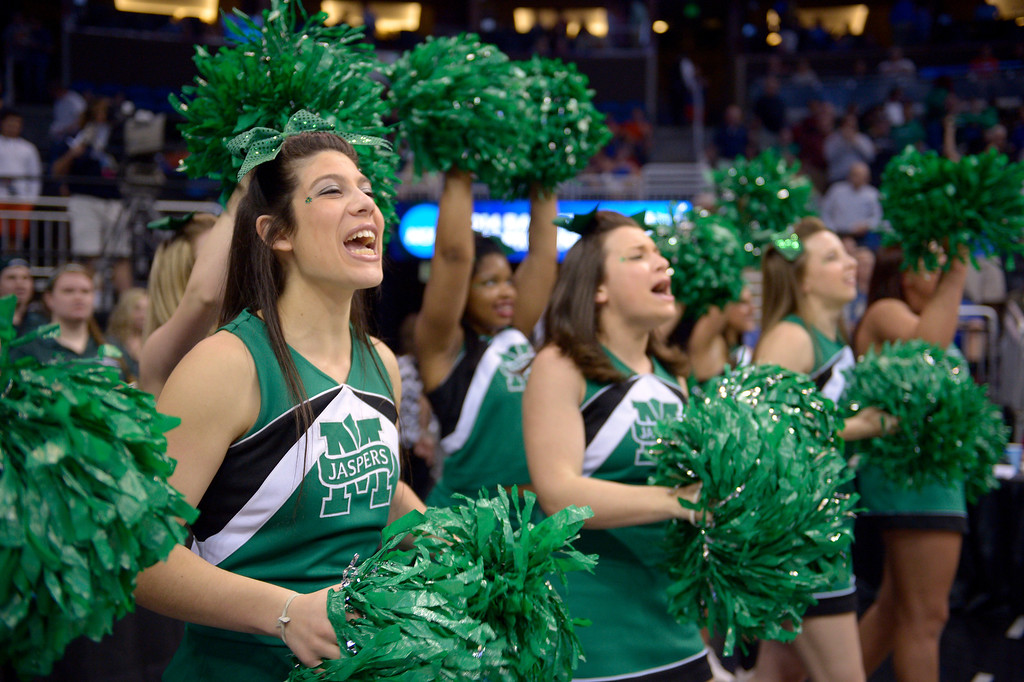 . Manhattan cheerleaders cheer during the first half against Louisville in a second-round game in the NCAA college basketball tournament Thursday, March 20, 2014, in Orlando, Fla. (AP Photo/Phelan M. Ebenhack)