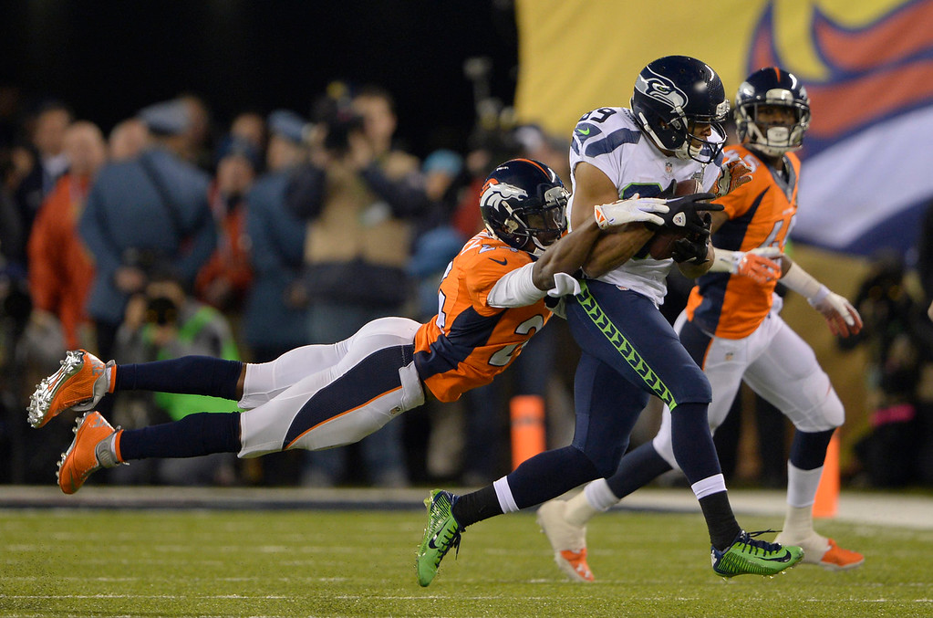 . Denver Broncos cornerback Champ Bailey (24) gets a hold of Seattle Seahawks wide receiver Doug Baldwin (89) during the fourth quarter. The Denver Broncos vs the Seattle Seahawks in Super Bowl XLVIII at MetLife Stadium in East Rutherford, New Jersey Sunday, February 2, 2014. (Photo by Joe Amon/The Denver Post)