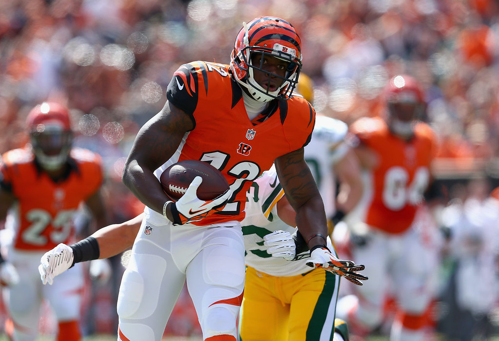 . Mohamed Sanu #12 of the Cincinnati Bengals runs with the ball during the NFL game against the Green Bay Packers at Paul Brown Stadium on September 22, 2013 in Cincinnati, Ohio.  (Photo by Andy Lyons/Getty Images)
