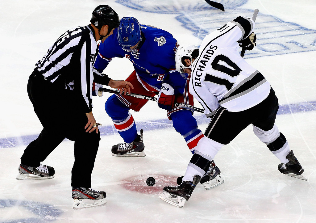 . Derick Brassard #16 of the New York Rangers and Mike Richards #10 of the Los Angeles Kings face-off during the first period of Game Four of the 2014 NHL Stanley Cup Final at Madison Square Garden on June 11, 2014 in New York, New York.  (Photo by Jim McIsaac/Getty Images)