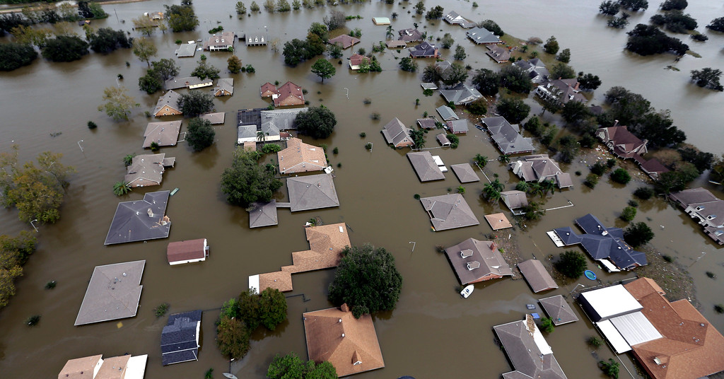 . In this Aug. 31, 2012 file aerial photo, homes flooded by Hurricane Isaac in Braithwaite, La., are seen. (AP Photo/David J. Phillip, File)