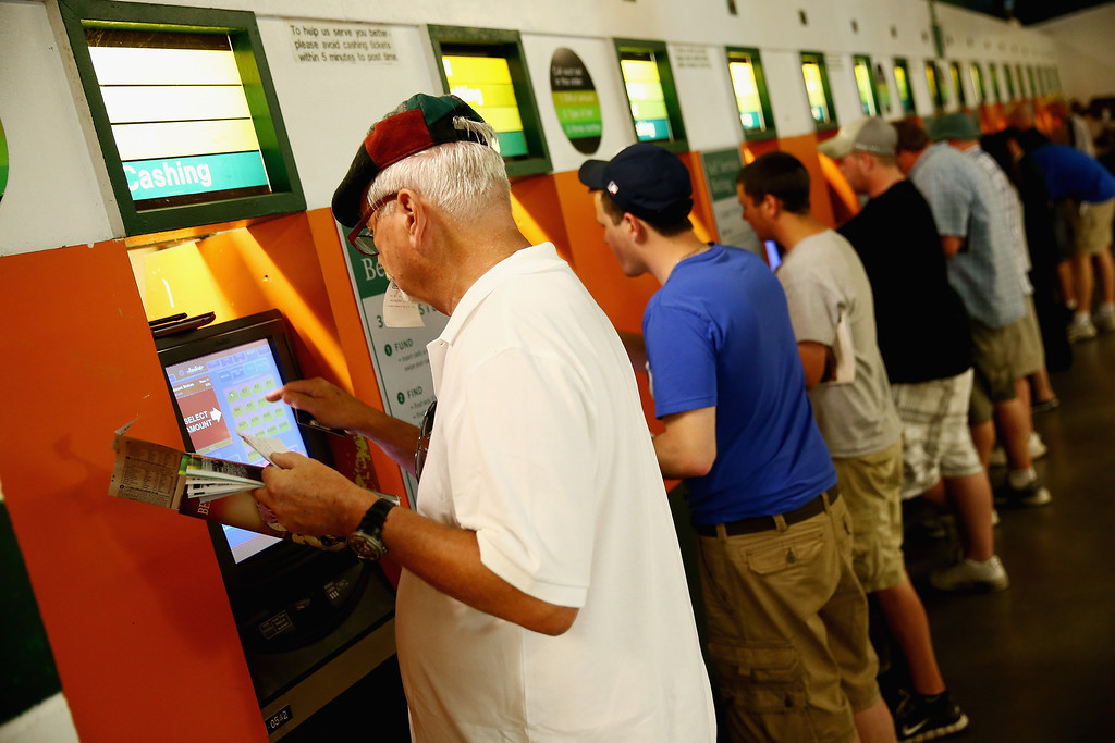 . ELMONT, NY - JUNE 07:  Fans place bets prior to the Belmont Stakes at Belmont Park on June 7, 2014 in Elmont, New York.  (Photo by Streeter Lecka/Getty Images)