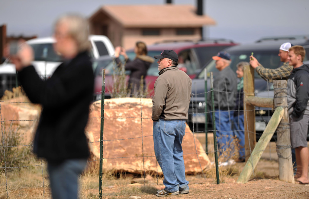. FORT COLLINS, CO. - MARCH 16: People watch the Galena wildfire in Larimer County. The wild fire pushed west overnight through Lory State Park, driven by wind gusts reaching 45 mph. Fort Collins, Colorado. March 16, 2013. (Photo By Hyoung Chang/The Denver Post)