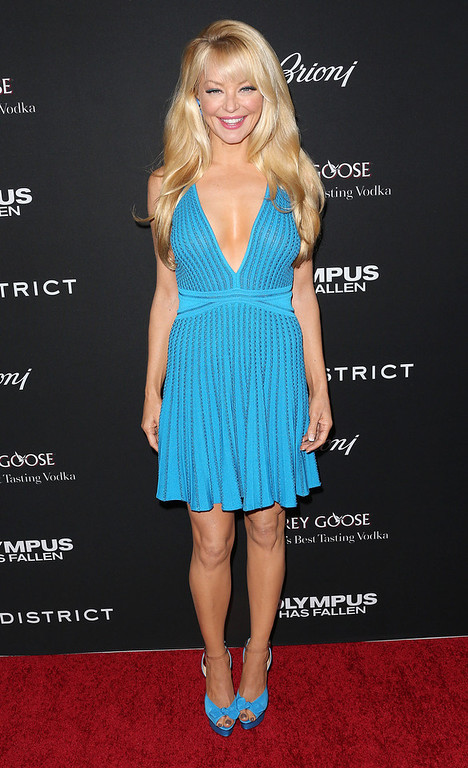 """. Actress Charlotte Ross attends the Premiere of FilmDistrict\'s \""""Olympus Has Fallen\"""" at the ArcLight Cinemas Cinerama Dome on March 18, 2013 in Hollywood, California.  (Photo by Frederick M. Brown/Getty Images)"""