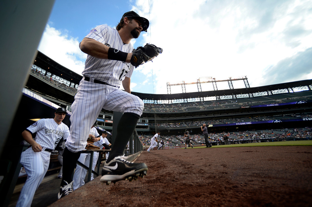 . Todd Helton (17) of the Colorado Rockies heads out to the field from the dugout in their game against the San Francisco Giants May 16, 2013 at Coors Field. (Photo By John Leyba/The Denver Post)
