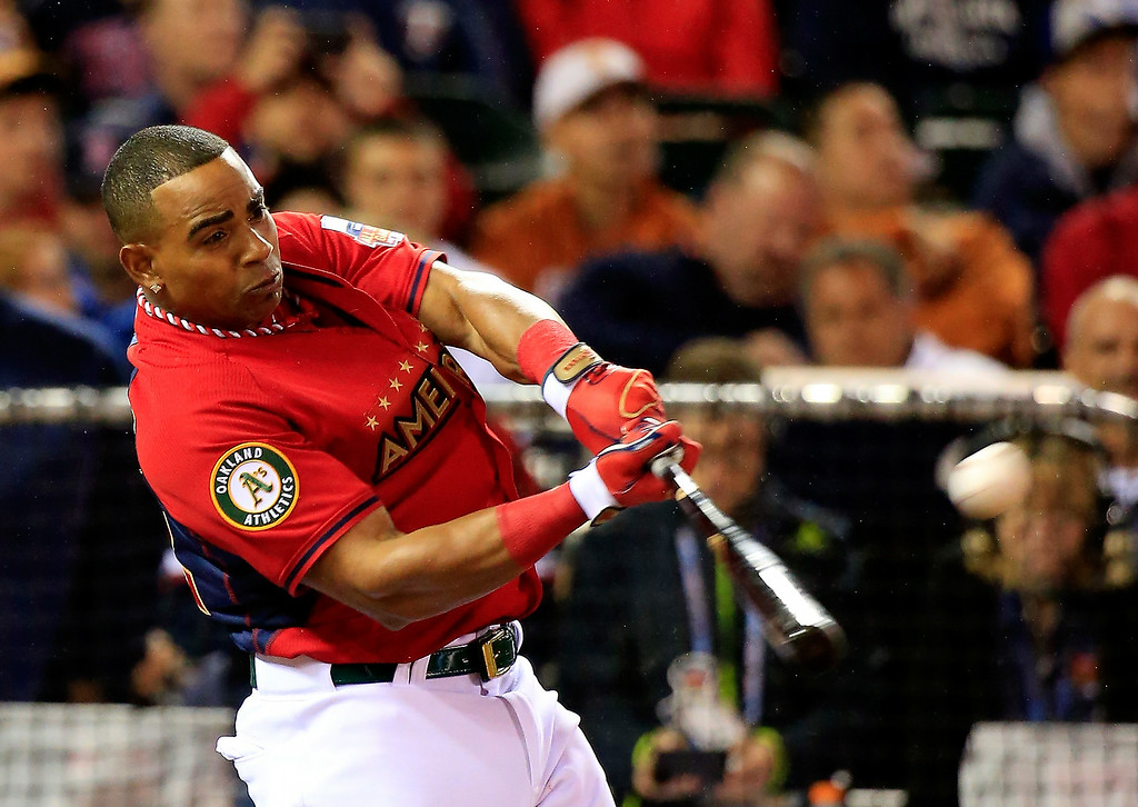 . American League All-Star Yoenis Cespedes #52 of the Oakland A\'s bats during the Gillette Home Run Derby at Target Field on July 14, 2014 in Minneapolis, Minnesota.  (Photo by Rob Carr/Getty Images)