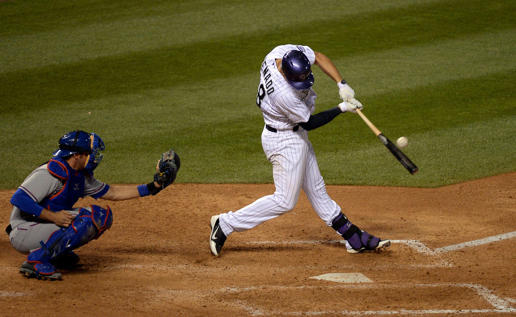 . DENVER, CO - MAY 06: Colorado Rockies third baseman Nolan Arenado (28) hits a double down the left field line to keep his hitting streak alive at 26 games against the Texas Rangers May 6, 2014 at Coors Field. (Photo by John Leyba/The Denver Post)