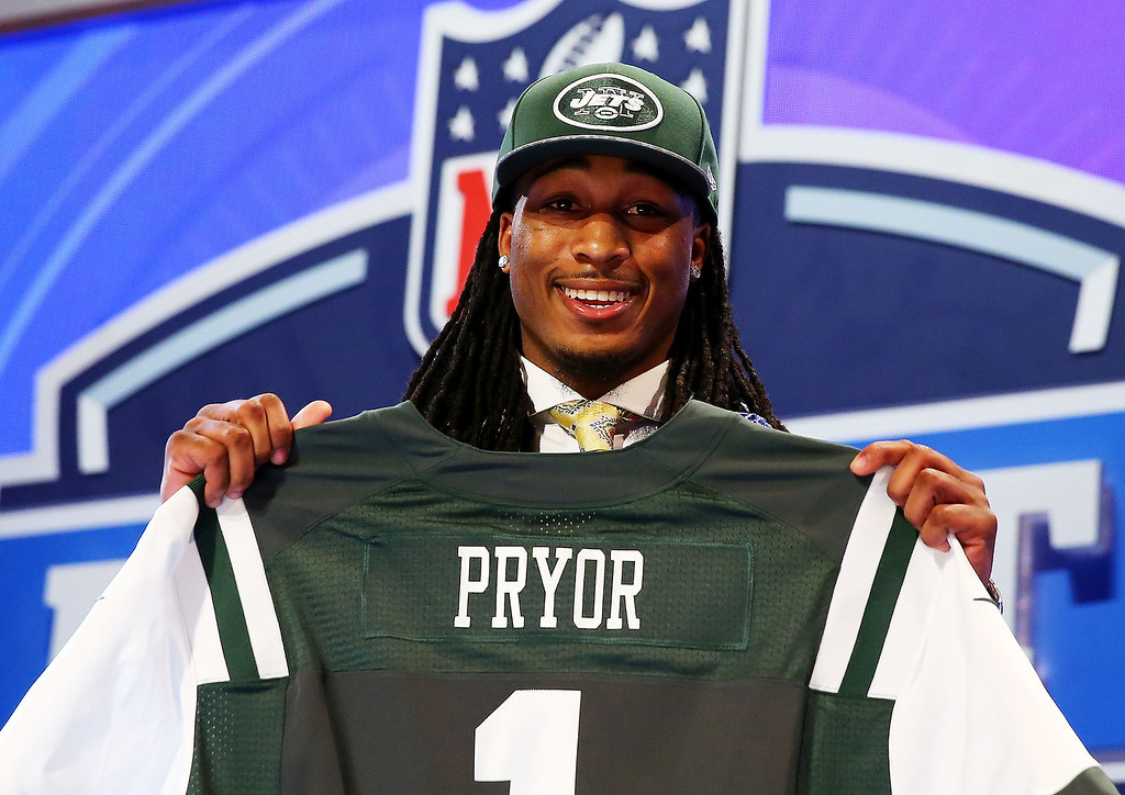 . Calvin Pryor of the Louisville Cardinals poses with a jersey after he was picked #18 overall by the New York Jets during the first round of the 2014 NFL Draft at Radio City Music Hall on May 8, 2014 in New York City.  (Photo by Elsa/Getty Images)