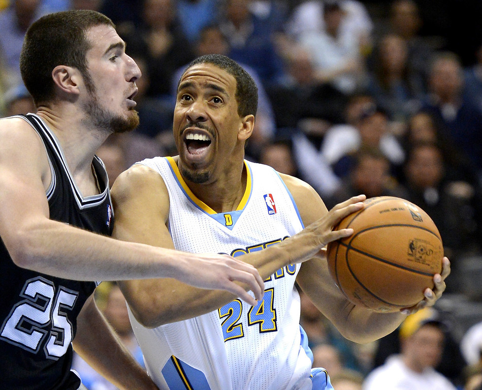 . Denver Nuggets Andre Miller (24) drives on San Antonio Spurs Nado De Colo (25) during the third quarter April 10, 2013 at Pepsi Center. (Photo By John Leyba/The Denver Post)