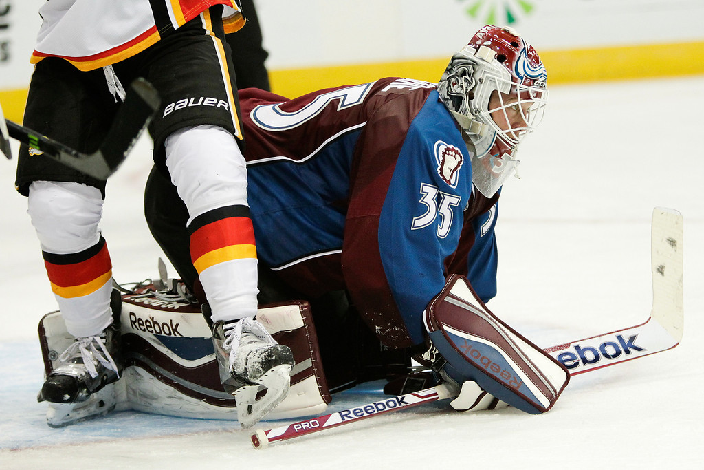 . Colorado Avalanche goalie Jean-Sebastien Giguere (35) kneels in goal during the second period of an NHL hockey game against the Calgary Flames, Friday, Nov. 8, 2013, in Denver. (AP Photo/Barry Gutierrez)