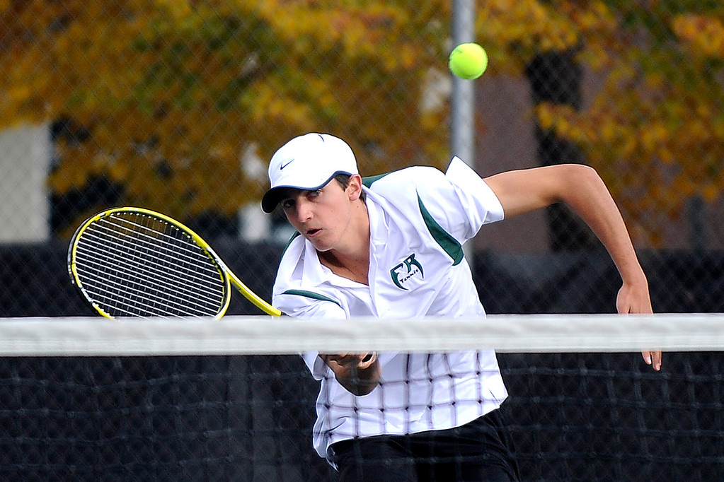 . DENVER, CO. - OCT 12:   Kevin Schultz of Fossil Ridge hits against Regis Jesuit opponents during a doubles match held on the final day of the 5A Boys\' Tennis Championships at Gates Tennis Center on Oct. 12, 2013.  (Photo By Erin Hull/The Denver Post)