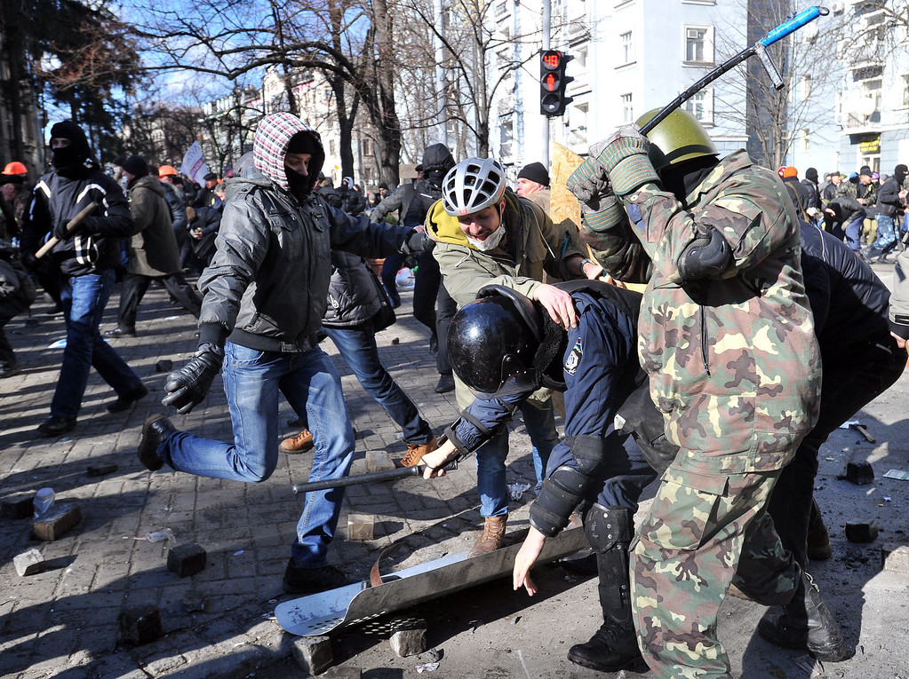 . Anti-government protesters clash with police in the center of Kiev on February 18, 2014. Police on Tuesday fired rubber bullets at stone-throwing protesters as they demonstrated close to Ukraine\'s parliament in Kiev, an AFP reporter at the scene said. Police also responded with smoke bombs after protesters hurled paving stones at them as they sought to get closer to the heavily-fortified parliament building. AFP PHOTO/GENYA SAVILOV/AFP/Getty Images