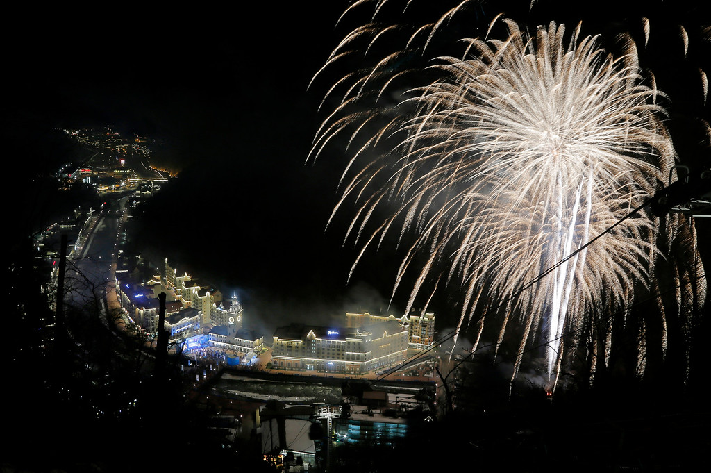 . Fireworks explode over Roza Khutor, near Krasnaya Polyana, Russia, the mountain Olympic cluster, Friday, Feb. 7, 2014, during opening of the 2014 Winter Olympics (AP Photo/Dmitry Lovetsky)