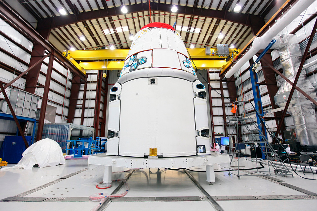 . The Space Exploration Technologies, or SpaceX, Dragon spacecraft stands inside a processing hangar at Cape Canaveral Air Force Station in Florida in this undated picture. NASA and its international partners are targeting Friday, March 1, 2013 as the launch date for the next cargo resupply flight to the International Space Station by SpaceX.  SpaceX\'s Dragon capsule will be filled with about 1,200 pounds of supplies for the space station crew and experiments being conducted aboard the orbiting laboratory.   REUTERS/Kim Shiflett/NASA/Handout