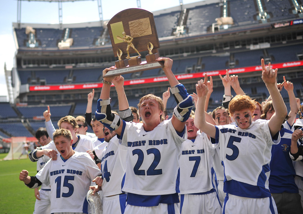 . DENVER, CO. - MAY 18 : Bennie Pachello (15), Pete Aplet (22),  Jensen Makarov (7), Jacob Gladfelter (5)  and Wheat Ridge High School players celebrate winning of 4A Boy\'s Lacrosse Championship game against Air Academy High School at Sports Authority Field at Mile High Stadium. Denver, Colorado. May 18, 2013. Wheat Ridge won 14-2. (Photo By Hyoung Chang/The Denver Post)