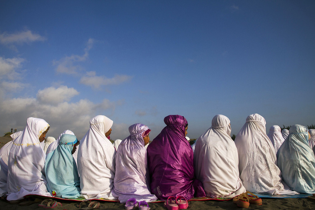 . Indonesian Muslims attend early morning Eid al-Fitr prayers near the coast in Bantul, Yogyakarta in central Java island on August 8, 2013. Tens of millions of Muslims in Indonesia celebrated the Eid al-Fitr holiday on August 8 following the end of Ramadan. SURYO WIBOWO/AFP/Getty Images