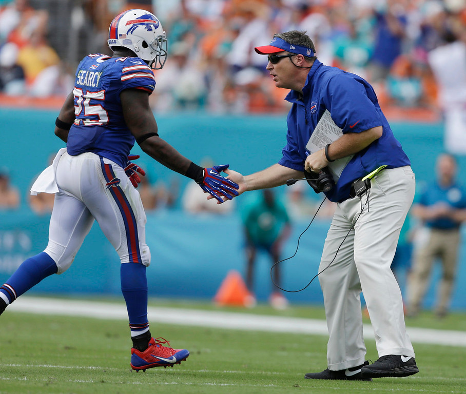. Buffalo Bills head coach Doug Marrone greets Buffalo Bills strong safety Da\'Norris Searcy (25) after a play during the first half of an NFL football game against the Miami Dolphins, Sunday, Oct. 20, 2013, in Miami Gardens, Fla. (AP Photo/Lynne Sladky)