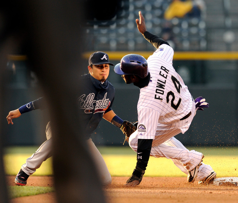 . DENVER, CO. - APRIL 23:  Colorado speedster Dexter Fowler stole second base in the first inning with Atlanta infielder Ramiro Pena covering the bag. The Colorado Rockies hosted the Atlanta Braves in the second game of a doubleheader Tuesday night April 23, 2013 at Coors Field. Photo By Karl Gehring/The Denver Post