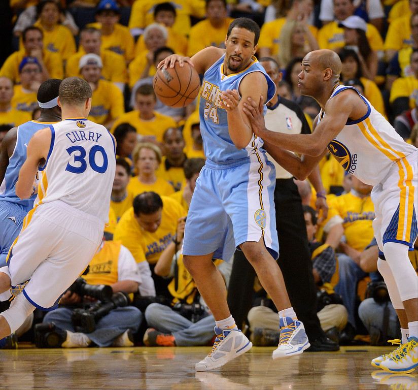 . Andre Miller (24) of the Denver Nuggets dribbles around Stephen Curry (30) of the Golden State Warriors as Jarrett Jack (2) covers him late in the fourth quarter in Game 6 of the first round NBA Playoffs May 2, 2013 at Oracle Arena. (Photo By John Leyba/The Denver Post)