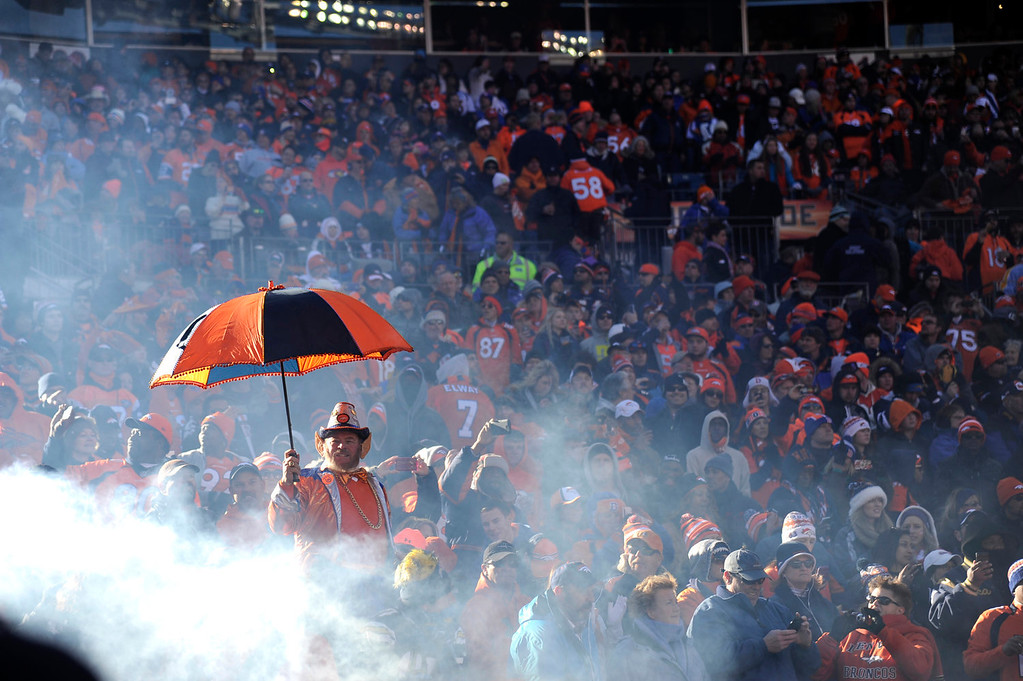 . Denver Broncos fans prepare for the game. The Denver Broncos vs. The San Diego Chargers in an AFC Divisional Playoff game at Sports Authority Field at Mile High in Denver on January 12, 2014. (Photo by Joe Amon/The Denver Post)