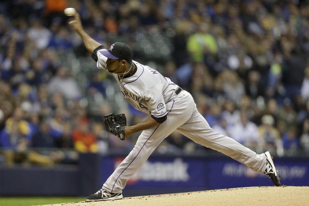 . MILWAUKEE, WI - APRIL 3:  Juan Nicasio #44 of the Colorado Rockies pitches in the bottom of the first inning against the Milwaukee Brewers during the game at Miller Park on April 3, 2013 in Milwaukee, Wisconsin.  (Photo by Mike McGinnis/Getty Images)