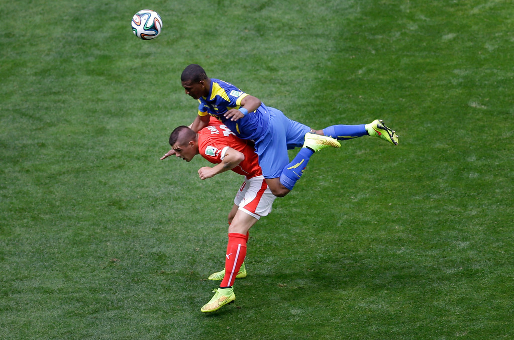 . Switzerland\'s Granit Xhaka, left, and Ecuador\'s Carlos Gruezo challenge for the ball during the group E World Cup soccer match between Switzerland and Ecuador at the Estadio Nacional in Brasilia, Brazil, Sunday, June 15, 2014. (AP Photo/Themba Hadebe)