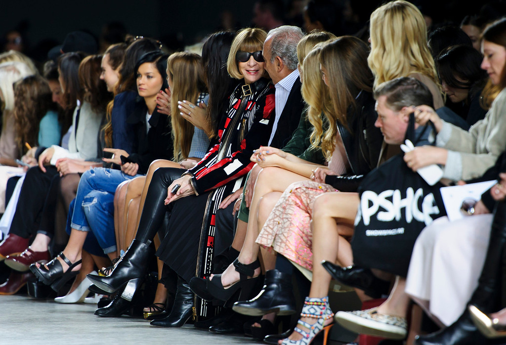 . Centre, British Editor-in-chief of American Vogue Anna Wintour in the front row during the Topshop Unique collection at London Fashion Week Autumn/Winter 2014, at the Tate Modern in central London, Sunday, Feb. 16, 2014. (Photo by Jonathan Short/Invision/AP)