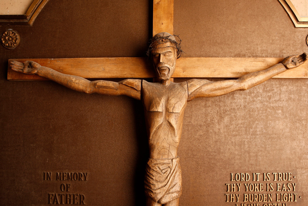 . The hand carved wooden crucifix that was carried by Capt. Joseph O\'Connor, Warrant Officer Felix McCool and Lt. Ralph Nardella, to Freedom Village, Korea at the end of the Korean Conflict. The crucifix was carved by a Jewish marine Gerald Fink who was imprisoned with Fr. Kapaun in his memory. Today the crucifix hangs at Kapaun Mount Carmel High School. (Bo Rader/Wichita Eagle/MCT)