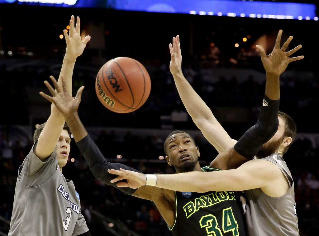 . Baylor\'s Cory Jefferson (34) loses the ball as Creighton\'s Ethan Wragge, right, and Doug McDermott (3) defend during the second half of a third-round game in the NCAA college basketball tournament Sunday, March 23, 2014, in San Antonio. Baylor won 85-55. (AP Photo/David J. Phillip)