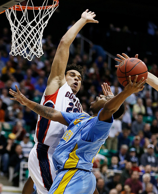 . Gonzaga\'s Elias Harris, left tries to block the shot of Southern University\'s Jameel Grace in the first half during a second-round game in the NCAA college basketball tournament in Salt Lake City, Thursday, March 21, 2013. (AP Photo/George Frey)