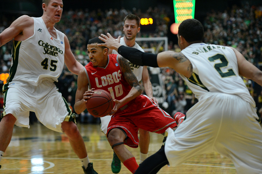 . Fort COLLINS, CO. - FEBRUARY 23: New Mexico Kendall Williams drives past CSU (l-r) Colton Iverson, Wes Eikmeier and Daniel Bejarano during first half action at Moby Arena in Fort Collin, CO February  24, 2013. The Colorado State Rams lost to the New Mexico Lobos 91-82. (Photo By Craig F. Walker/The Denver Post)