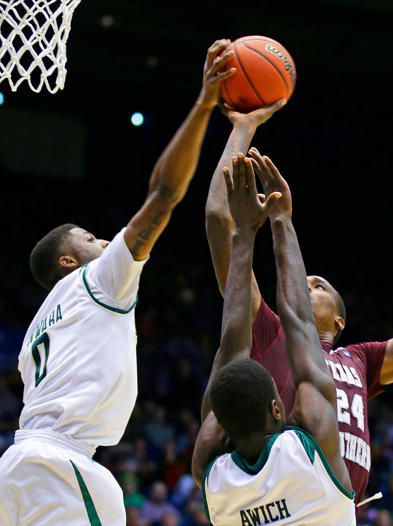 . Cal Poly guard Dave Nwaba (0) blocks a shot by Texas Southern center Aaric Murray (24) in the second half of a first-round game of the NCAA college basketball tournament on Wednesday, March 19, 2014, in Dayton, Ohio. (AP Photo/Al Behrman)