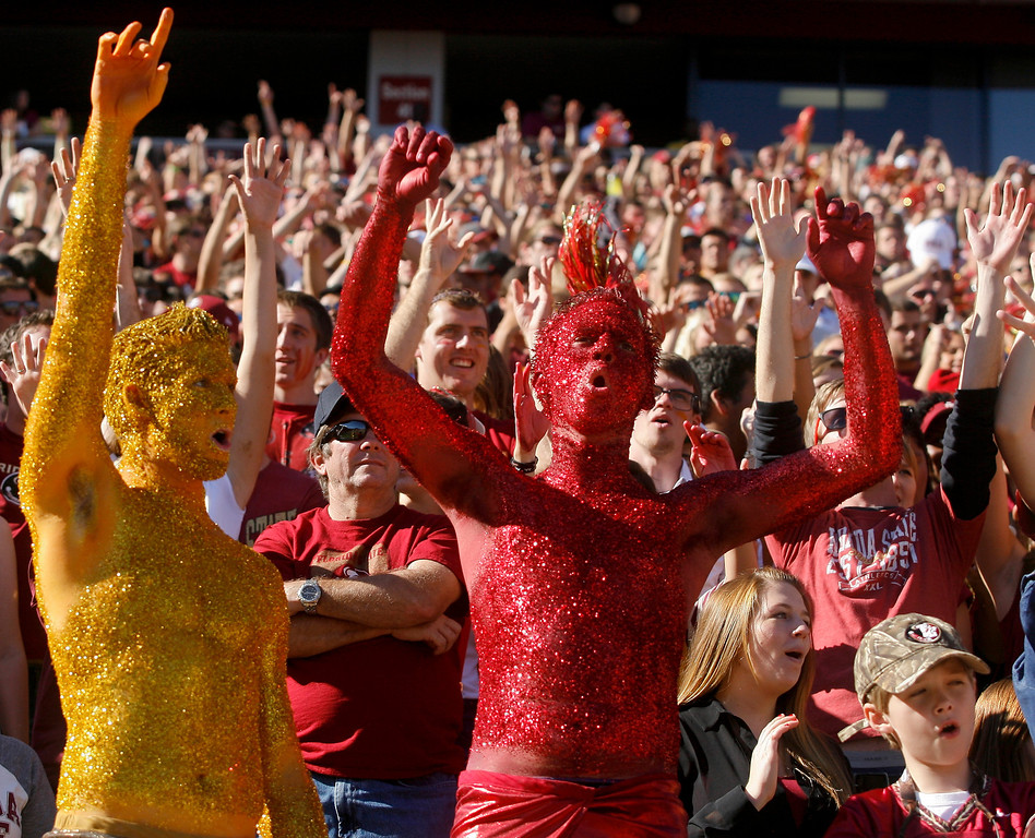 . Florida State fans, including the Garnet and Gold Guys, celebrate a touchdown in the first quarter of an NCAA college football game against North Carolina State, Saturday, Oct. 26, 2013, in Tallahassee, Fla. Florida State won 49-17. (AP Photo/Phil Sears)