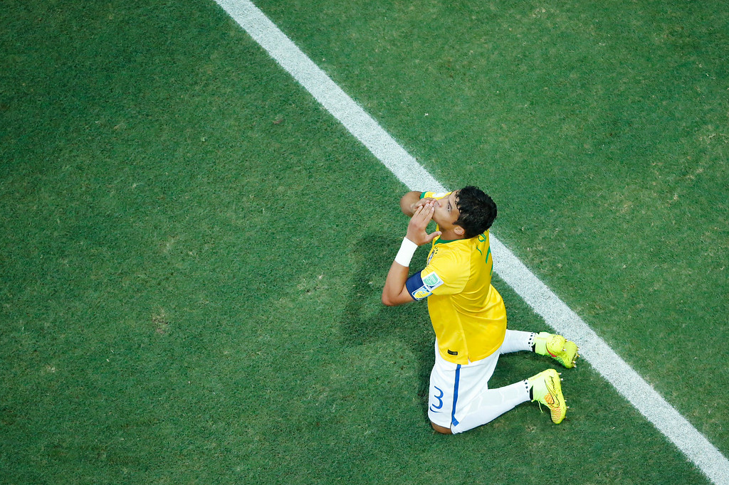 . Brazil\'s defender and captain Thiago Silva celebrates after scoring a goal during the quarter-final football match between Brazil and Colombia at the Castelao Stadium in Fortaleza during the 2014 FIFA World Cup on July 4, 2014. FABRIZIO BENSCH/AFP/Getty Images