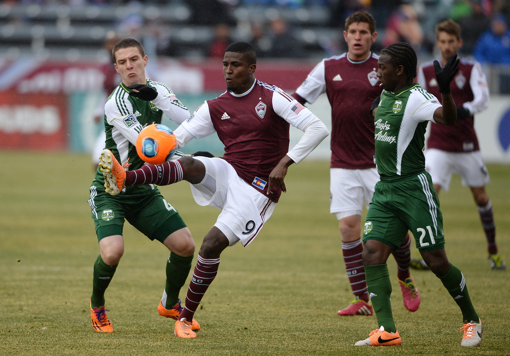 . COMMERCE CITY MARCH 22: Edson Buddle of Colorado Rapids (9), center, controls the ball between Will Johnson (4), left, and Diego Chara (21) of Portland Timbers in the 1st half of the game at Dick\'s Sporting Goods Park. Commerce City, Colorado. March 22. 2014. Colorado won 2-0. (Photo by Hyoung Chang/The Denver Post)