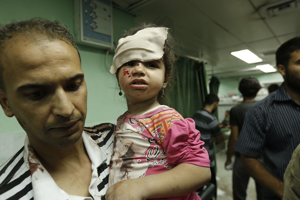 ". A Palestinian child, wounded in an Israeli strike on a compound housing a UN school in Beit Lahia in the northern Gaza Strip, receives treatment at Kamal Edwan hospital in Beit Lahia early on July 30, 2014.  Israeli bombardments early on July 30 killed ""dozens\"" of Palestinians in Gaza, including at least 16 at a UN school, medics said, on day 23 of the Israel-Hamas conflict.     AFP PHOTO / MOHAMMED  ABED/AFP/Getty Images"