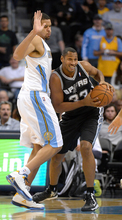 . San Antonio Spurs power forward Boris Diaw (33) runs in to Denver Nuggets center JaVale McGee (34) during the first quarter October 14, 2013 at Pepsi Center. (Photo By John Leyba/The Denver Post)