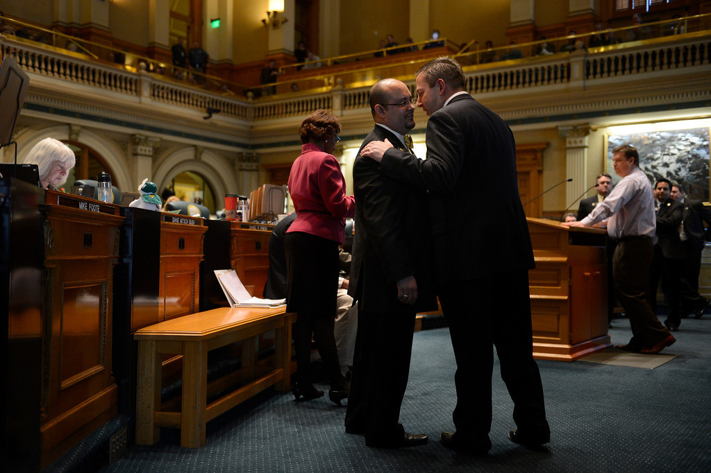 . DENVER, CO. - FEBRUARY 15: Minority Leader Mark Waller talks with Representative Joe Salazar on the floor during argument for HB 1224 prohibiting large capacity ammunition magazines in the Colorado House at the Denver State Capitol February 15, 2013. Denver, Colorado. (Photo By Joe Amon/The Denver Post)