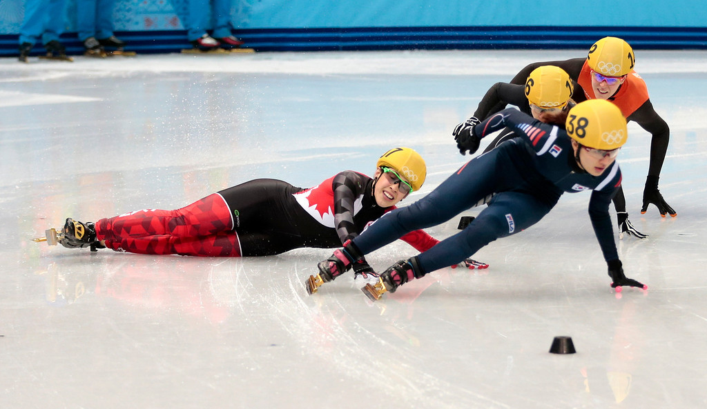 . Valerie Maltais of Canada, left, crashes out as she competes in a women\'s 1000m short track speedskating semifinal at the Iceberg Skating Palace during the 2014 Winter Olympics, Friday, Feb. 21, 2014, in Sochi, Russia. (AP Photo/Ivan Sekretarev)