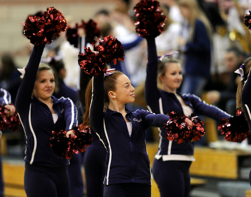 . The Cougars cheer squad performed during a time out. The Cherokee Trail boy\'s basketball team defeated Overland 59-57 Friday night, January 11, 2013. Karl Gehring/The Denver Post