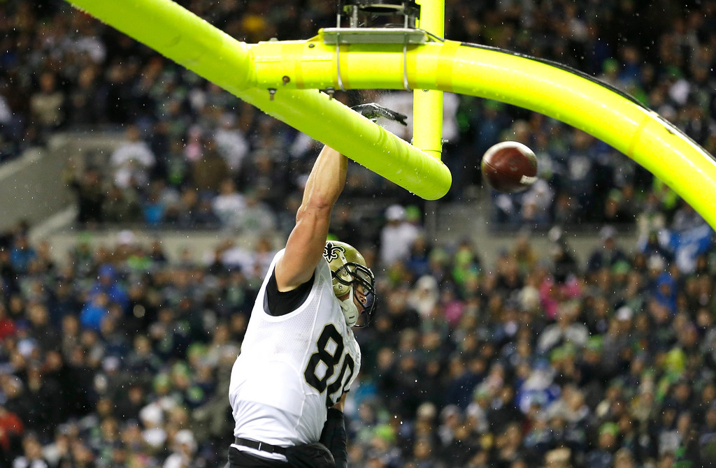 . New Orleans Saints\' Jimmy Graham spikes the ball through the goal posts after he scored a touchdown in the first half of an NFL football game against the Seattle Seahawks, Monday, Dec. 2, 2013, in Seattle. (AP Photo/Elaine Thompson)
