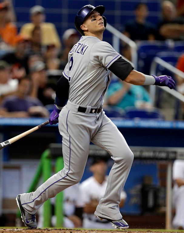 . Colorado Rockies shortstop Troy Tulowitzki watches after hitting a single in the first inning of a baseball game against the Miami Marlins, Thursday, April 3, 2014, in Miami. (AP Photo/Lynne Sladky)