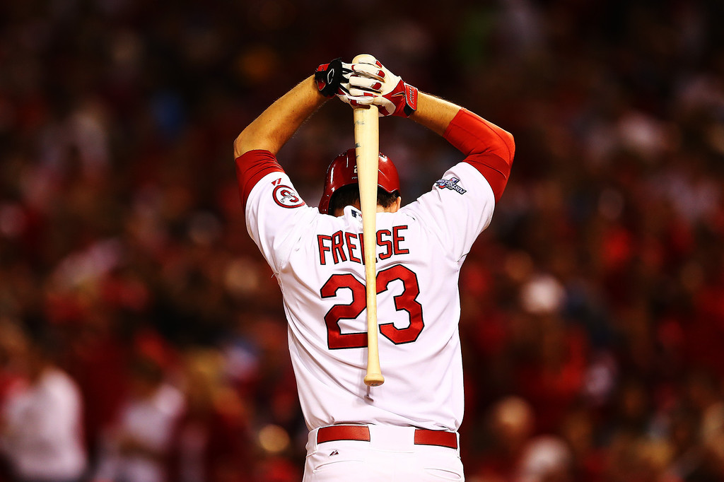 . David Freese #23 of the St. Louis Cardinals reacts after striking out to end the sixth inning against the Pittsburgh Pirates during Game Five of the National League Division Series at Busch Stadium on October 9, 2013 in St Louis, Missouri.  (Photo by Elsa/Getty Images)
