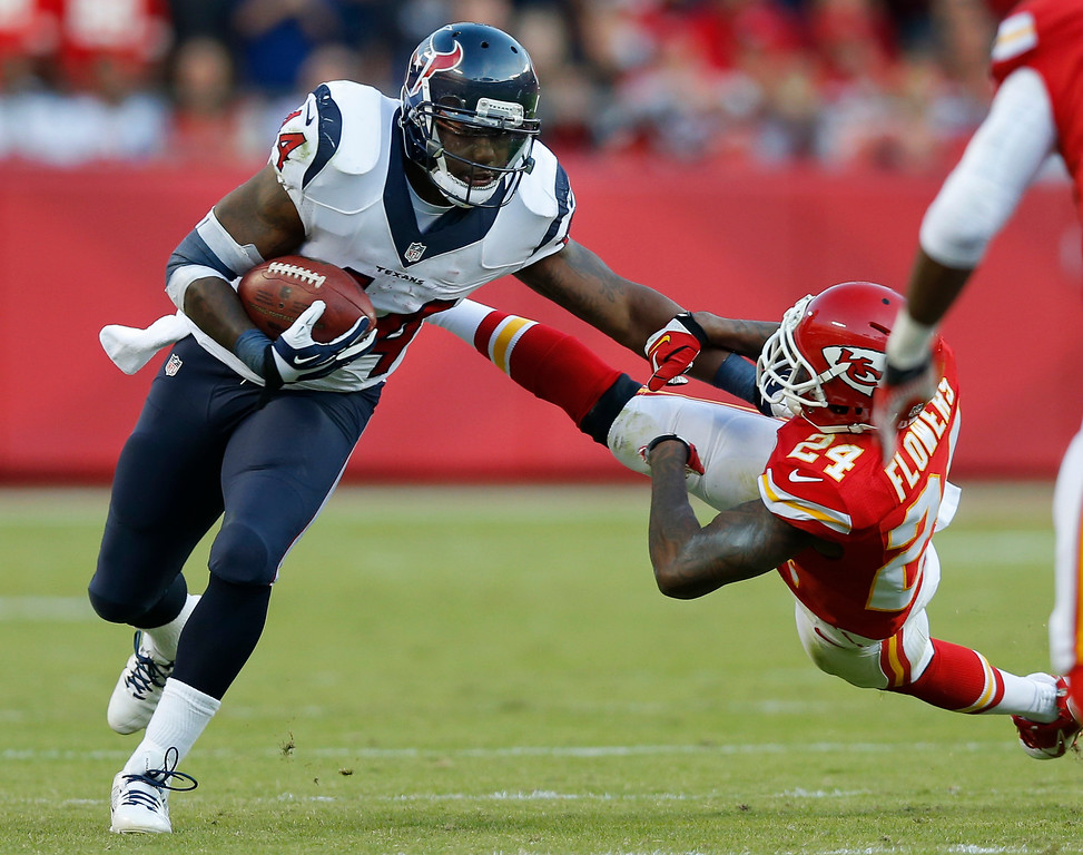 . Houston Texans defensive back Elbert Mack (44) is forced out of bounds by Kansas City Chiefs cornerback Brandon Flowers (24) during the second half of an NFL football game at Arrowhead Stadium in Kansas City, Mo., Sunday, Oct. 20, 2013. (AP Photo/Ed Zurga)