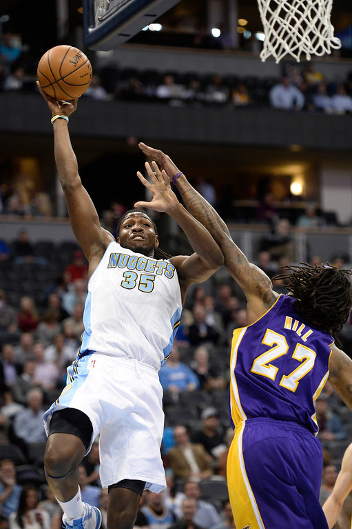 . DENVER, CO - NOVEMBER 13: Denver Nuggets power forward Kenneth Faried (35) takes a jump hook over Los Angeles Lakers center Jordan Hill (27) during the first quarter November 13, 2013 at Pepsi Center. (Photo by John Leyba/The Denver Post)