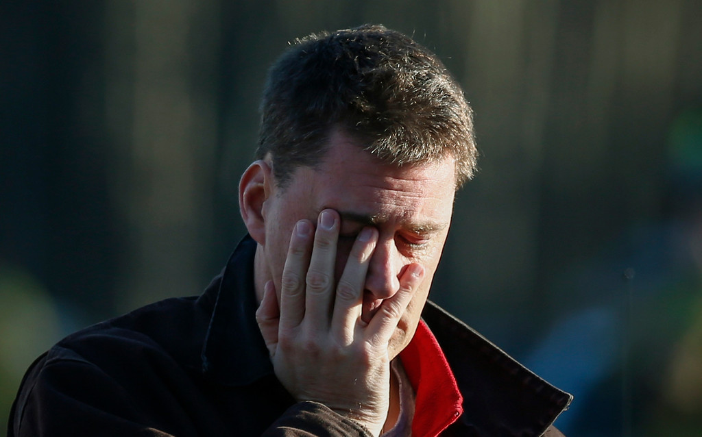 . A man mourns nearby Sandy Hook Elementary School where a gunman opened fire on school children and staff in Newtown, Connecticut on December 14, 2012. A heavily armed gunman opened fire on school children and staff at a Connecticut elementary school on Friday, killing at least 26 people, including 18 children, in the latest in a series of shooting rampages that have tormented the United States this year.     REUTERS/Adrees Latif