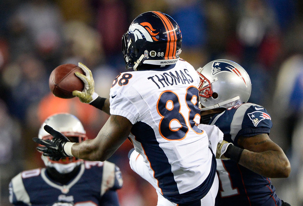 . Aqib Talib knocks the ball away from Denver Broncos wide receiver Demaryius Thomas (88) on a fourth down play in overtime November 24, 2013 at Gillette Stadium. (Photo by John Leyba/The Denver Post)