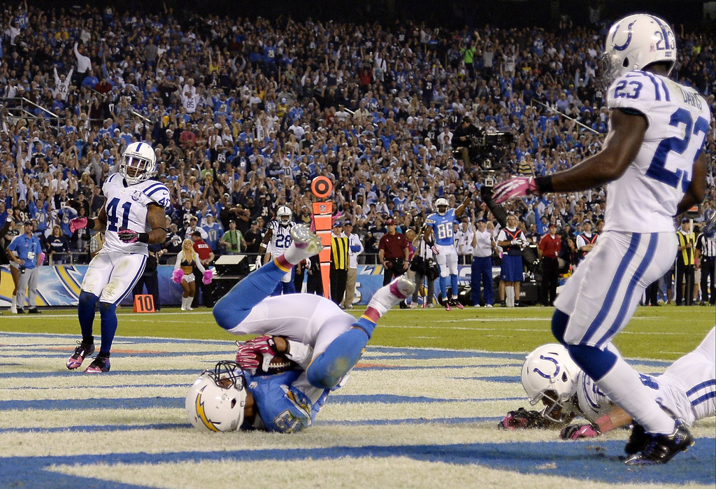 . Keenan Allen #13 of the San Diego Chargers scores a touchdown against Indianapolis Colts during the second quarter at Qualcomm Stadium October 14, 2013 in San Diego, California.  (Photo by Kevork Djansezian/Getty Images)